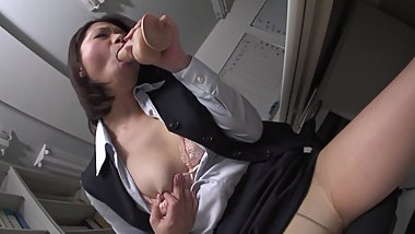 Petite brunette tired of boring office work and rides dildo in the workplace
