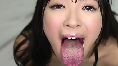 2 asian girls tongue out