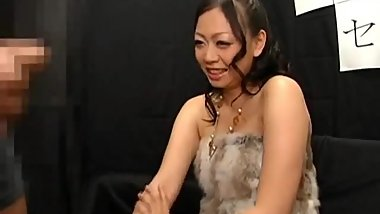 Busty Japanese milf watches guy jerk off up close