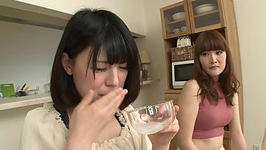 japanese girl drinks her friends saliva