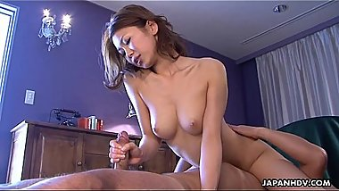 Asian beauty has a titty fuck and a cock suck performance