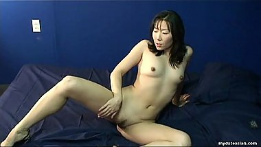 Brunette Asian sweet heat toys her tender holes