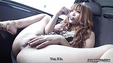 Delicious Japanese gal masturbating in a car